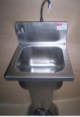 Sanitary wash basin with foot valve